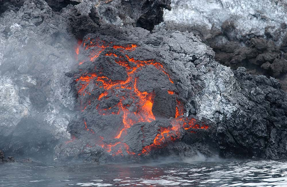 Volcanic Eruptions Reduce Flow Of Major Rivers, New Study Shows 1 sea water nature ocean steam shore 1138914