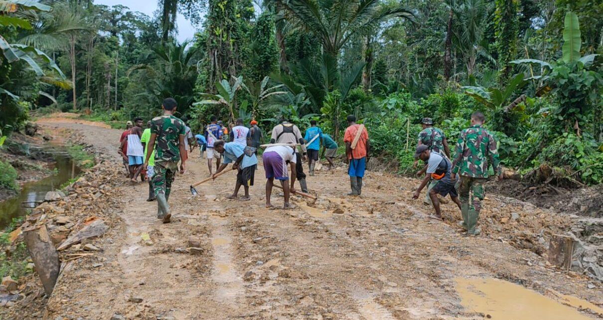 TNI Bersama Masyarakat Gotong Royong Lakukan Pengerasan Jalan 375 Meter di Kampung Idoor 1 IMG 20210619 WA0023